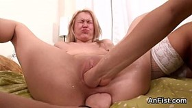 hot lesbo honeys are stretching and fisting asshol