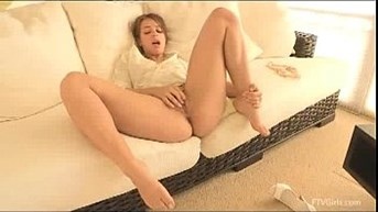 Sofia plays with shaved cunt before she masturbates
