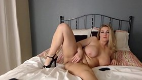 hot blonde woman strips and fingers her pus