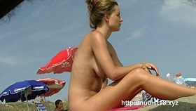 Hot chicks get naked on the beach for the spy cam