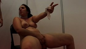 amazing squirting of a young woman in a public school