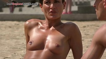 Tanned beautiful girl Topless on the Beach