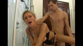 blonde sucks then fucks big cock in bathro