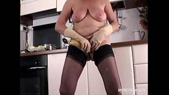 My wifeamps slut in stockings masturbates in the kitchen with a ladle and a banana