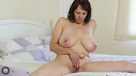 busty european mature undressing and rubbing pussy