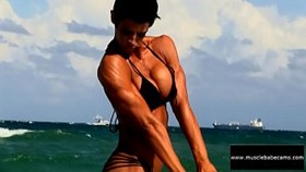 allie stauss beach flexing muscle