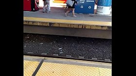 midget with thick legs across platform