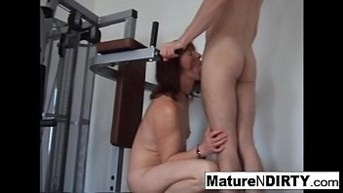 pierced granny gets an anal workout in the gym