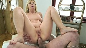 older woman enjoys massage and anal s